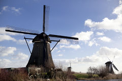 The old Dutch windmills, Holland, rural expanses . Windmills, the symbol of Holland. Holland windmill on a canal. Old mill chalk and flour . The beautiful Stock Images