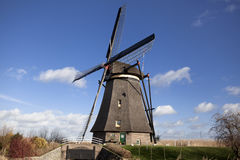 The old Dutch windmills, Holland, rural expanses . Windmills, the symbol of Holland. Holland windmill on a canal. Old mill chalk and flour . The beautiful Stock Image