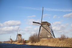 The old Dutch windmills, Holland, rural expanses . Windmills, the symbol of Holland. Holland windmill on a canal. Old mill chalk and flour . The beautiful Royalty Free Stock Photo