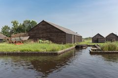 Old Dutch wooden barns near canal Stock Photography