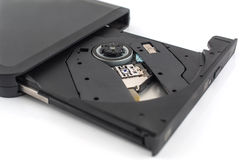 Old DVD-ROM in drive on white Royalty Free Stock Image