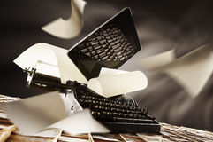 Old e new typewriter. An old typewriter and a modern tablet stock photo