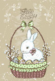 Old Easter card with rabbit in basket. Old Easter card with rabbit, painted eggs and willow in wicker basket on vintage textured background with lettering. Line Stock Images