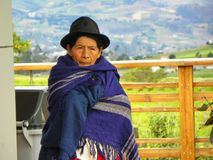 Old ecuadorian woman sitting outdoor stock photos