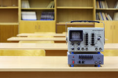 Old educational oscilloscope on desk Royalty Free Stock Image