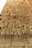 Old egypt hieroglyphs carved on the stone Stock Images