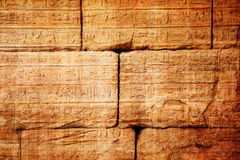 Old egypt hieroglyphs carved on the stone Stock Photos