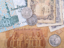 Old Egyptian banknotes and coins. Old Egyptian currency banknotes and coins Royalty Free Stock Photo