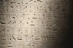Old egyptian hieroglyphs. Fading in the dark Stock Photography