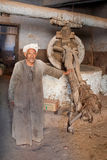 Old Egyptian worker in traditional galabeya Royalty Free Stock Photo