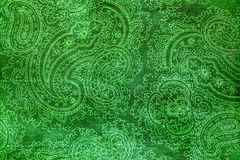 Old elaborate paisley pattern on paper. A detail from a print of an ornate bright green paisley pattern Stock Images