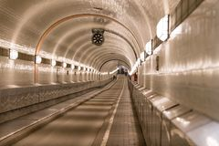 Old Elbtunnel in Hamburg. People walking through the old Elbtunnel in Hamburg Germany stock photography