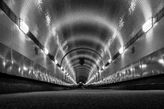 Old Elbtunnel in worm`s-eye view. Old Elbtunnel in Hamburg St. Pauli at Landungsbruecken in black and white Royalty Free Stock Images