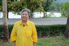 Old elder woman smiling. elderly female relaxing outdoors. senior lifestyle royalty free stock image