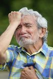 Senior Colombian Male Under Stress. An old elderly male adult Royalty Free Stock Photos