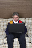 Old Elderly Senior Man Using Laptop Computer Royalty Free Stock Photo