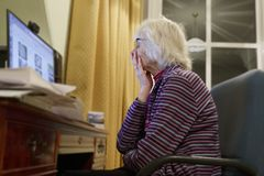 Old elderly senior person learning computer and online internet skills beware money fraud scam spam stock image