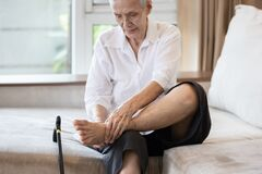 Free Old Elderly With Foot Injuries,ankle Bone Diseases,heel Pain Or Soles,asian Senior Woman Suffering From Peripheral Neuropathy, Stock Photo - 200000290
