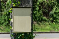 Old Electric box on post Stock Images