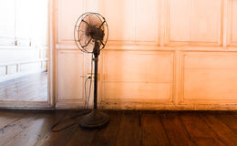 The old electric fan. Standing in the old home stock image