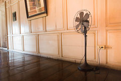 The old electric fan. Standing in the old home stock photography