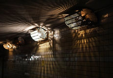 Old electric lamps in underground. Old electric lamp in underground passage Royalty Free Stock Photos