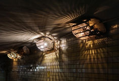 Old electric lamps in underground. Passage Stock Images
