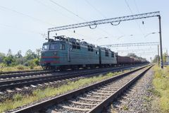 Old electric locomotive carrying industrial loads Royalty Free Stock Image