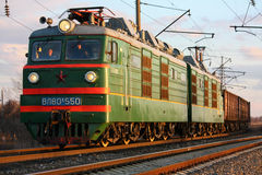 Old electric locomotive with freight train. Bataisk, Russia, 7 February 2012 royalty free stock image