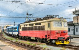 Old electric locomotive with a passenger train at Brno station, Czech Republic. Old electric locomotive with a passenger train at Brno Central Station, Czech Royalty Free Stock Photography