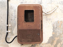 Old electric meter. On grungy aged wall Royalty Free Stock Image