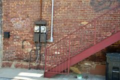 Old electric meters outside building. Old electric meter outside vintage brick building stock photography