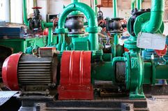 Old electric motor with cold water pump. Industrial background stock image