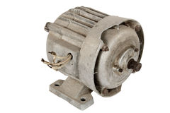 Old electric motor (isolated). Old electric motor, isolated on a white background royalty free stock image