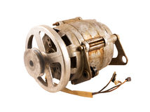 Old electric motor with pulley. Old electric motor with a pulley for drive belt Stock Photos