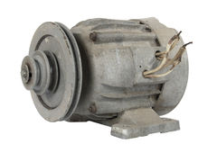 Old electric motor with a pulley (isolated) Royalty Free Stock Photography