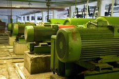 Old electric motors. At the factory stock photography