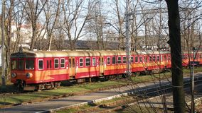 Old electric multiple unit En57 operated by Przewozy Regionalne on Cieszyn station in Poland. Red,and orange livery of old, local and regional transport train royalty free stock images