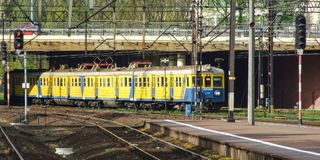 Electric multiple unit of SKM operator in Gdansk Central terminal. Old electric multiple unit EN57 operated by SKM Fast City Rail Triplecity operator approaching Stock Photography
