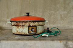 Old electric pan on ground. Stock Images