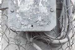 Old electric box with cracked paint and wire mesh. Old electric street box with cracked paint and wire mesh royalty free stock photo