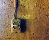 Old electric switch on concrete wall Stock Images