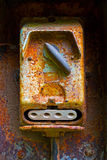 Old electric switch on rusty iron wall Stock Photo
