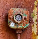 Old electric switch on a rusty iron wall Stock Photography