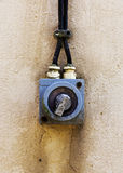 Old electric switch on the wall Royalty Free Stock Photos