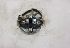 Old electric switch in the wall. Old disassembled electric switch in the wall Stock Photography