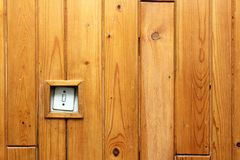 Old electric switch on wooden wall Stock Photography