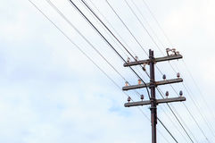 Old Electric transmission. Old Wooden Electric transmission Pole Royalty Free Stock Photography