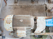 Old electric water pump, full of rust. Stock Photos
