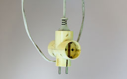 Old electrical cable extension plug Royalty Free Stock Photos